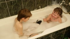 Two little brothers playing in the bath with foam, 4k footage Stock Footage