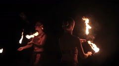 Fire show performance. Female fire performers dance with burning fire torches Stock Footage