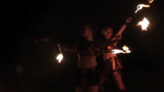 Fire show performance. Women female performers dance with burning fire torches Stock Footage