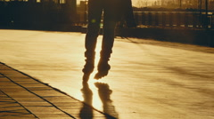 Silhouette of a man rollerblading at sunset in modern city - stock footage