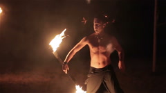 Fire show performance. Handsome male fire performer twirl and toss up fire baton - stock footage