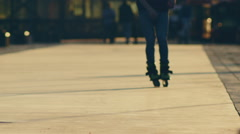 Silhouette of a people rollerblading at sunset - stock footage