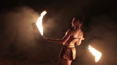 Fire show performance. Sexy woman female fire performer dance twirl fire snakes Stock Footage