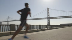 San Francisco bay bridge morning run at the bay foreshore - stock footage