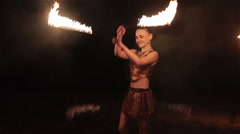 Fire show performance. Sexy woman female fire performer dance twirl fire snakes - stock footage