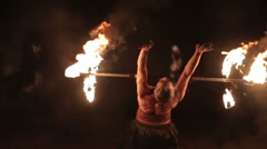 Fire performance. Fire juggler performs contact manipulation - fire dragon staff Stock Footage