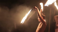 Fire show performance. Group of fire show performers dance twirling fire snakes Stock Footage