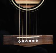 Detail of an acoustic black guitar Stock Photos