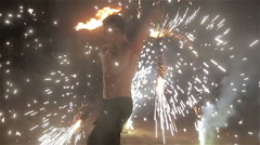 Fire show performance. Fire performer dance twirl sparkling firework baton staff Stock Footage
