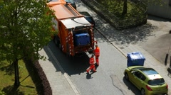 4K Urban City Municipal Communal Worker collecting household paper waste truck Stock Footage