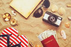 Summer vacation accessories on tropical sandy ocean beach, holidays abroad Stock Photos
