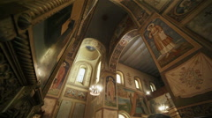 Interior decoration inside orthodox church - fresco and icons and chandelier - stock footage