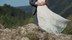 No face couple in love - man holds embracing woman standing at nature mountain Stock Footage