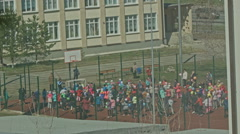 Children launch balloons at school playground Stock Footage