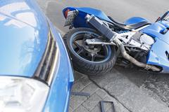 Accident motorcycle and cars on  road - stock photo