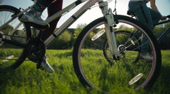 Steadicam shot of healthy man and woman pedaling fast. - stock footage
