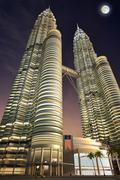 Petronas towers, night time, dramatic view from below. - stock illustration