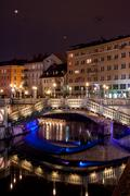 Triple bridge in Ljubljana at night Stock Photos