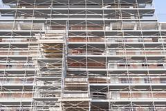 Building under construction with building armor. - stock photo