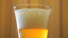 Jet of light beer fills in a beer mug on the table Stock Footage