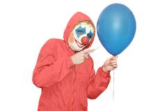 Clown in a red jacket Stock Photos