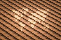 Tile roof texture surface with world map - stock photo
