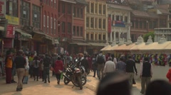 Nepal 1 Year After the Earthquake. Circumambulating Bodhnath 4K - stock footage