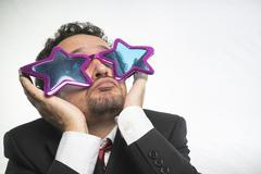Businessman with glasses stars, crazy and funny achiever Stock Photos