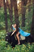 Beautiful woman riding horse in forest Stock Photos