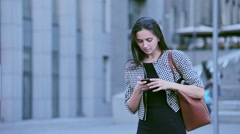 Beautiful young serious business woman in a hurry for a meeting - stock footage