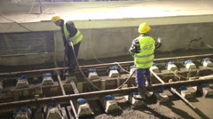 Underground subway tunnel workers pouring concrete Stock Footage