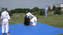 Aikido coach show fight exercise on mat in green park . 4K Stock Footage