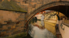 Water Stream Flowing Under Charles Bridge in Prague, Czech Republic (Czechia) Stock Footage