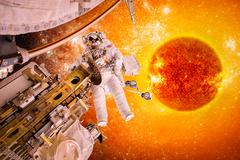 Spacecraft and astronauts in space on background sun star Stock Photos