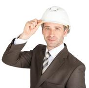 Businessman in suit raised his hard hat to greet Stock Photos