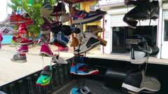 LAS TERRENAS, SAMANA, DOMENICAN REPUBLIC FEBRUARY 06 selling shoes at the mar Stock Footage