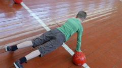 A pupil doing push ups during sport lesson at elementary school, Full HD shot Stock Footage