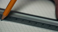 With a ruler and a pencil make line. - stock footage