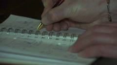 Man writes in the notebook. Hand and pen close-up. Stock Footage
