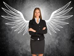 Businesswoman with drawn angel wings Kuvituskuvat