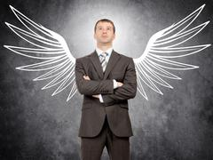 Businessman with angel wings Stock Photos