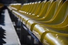 Plenty of yellow plastic seats Stock Photos