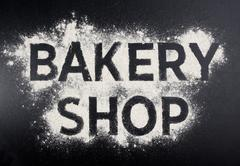 Bakery shop word made of flour. Baking store logo. Stock Photos