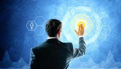 Man touch virtual screen. Glow elements - stock photo