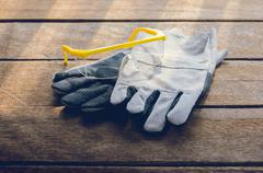 Protective gloves, goggles , Standard construction safety equipment Stock Photos