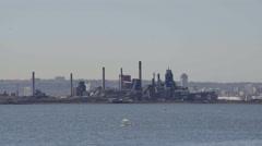Establishing shot of Steel Mill factories. Blast furnaces. 4K UHD. - stock footage