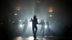 Silhouettes of girls dancing in a night club Stock Footage