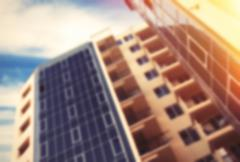 abstract unfocused picture of apartments building in sunlight - stock photo