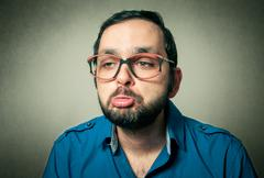 geek with the beard closeup portrait - stock photo