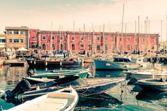 Street view of Naples harbor with boats, italy Europe - stock photo